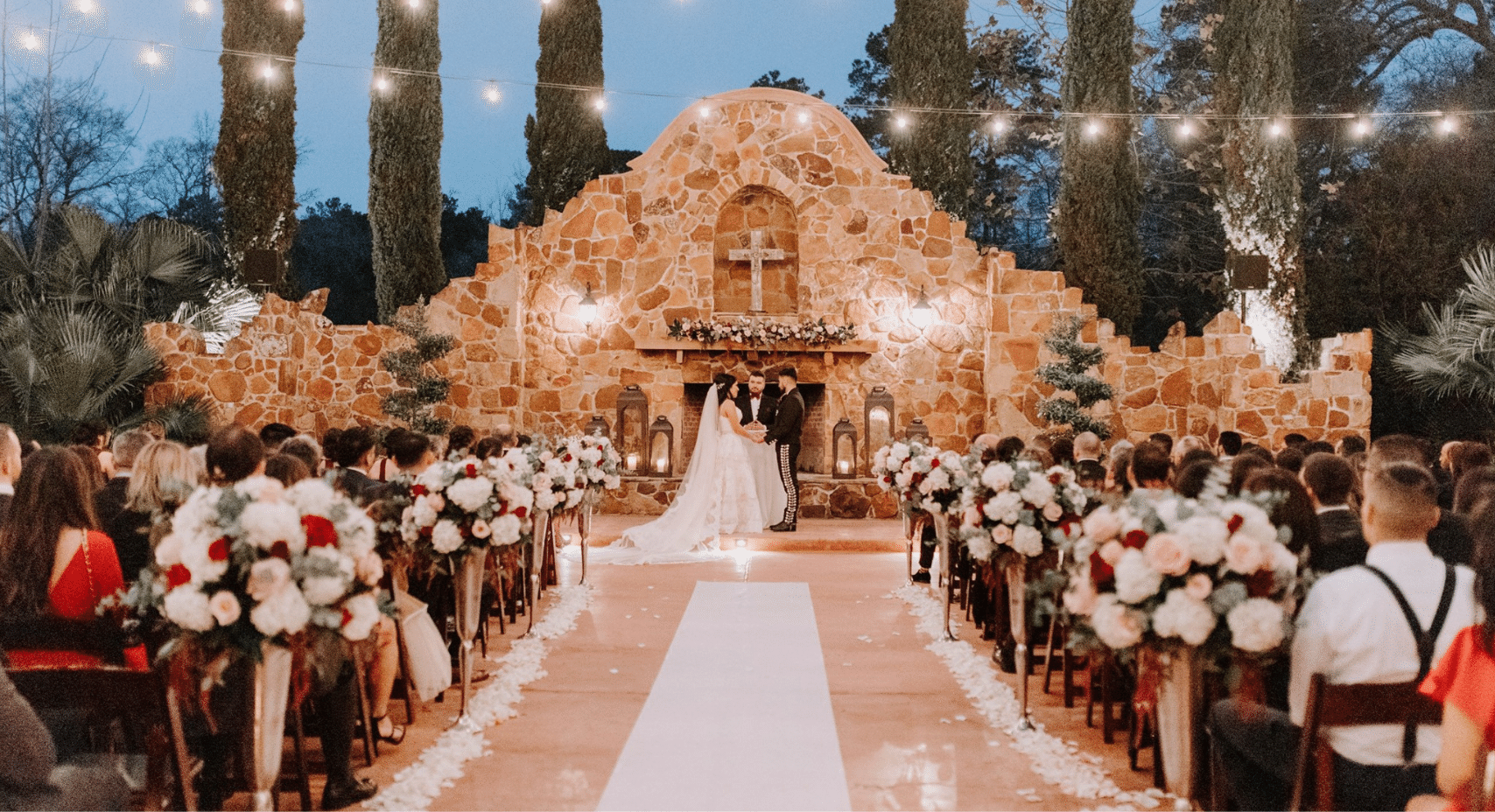 Bride and Groom In Front of Grand Fireplace
