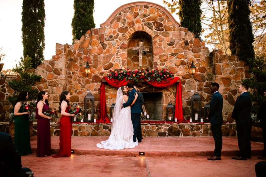 Outdoor ceremony near grand fireplace at Madera Estates